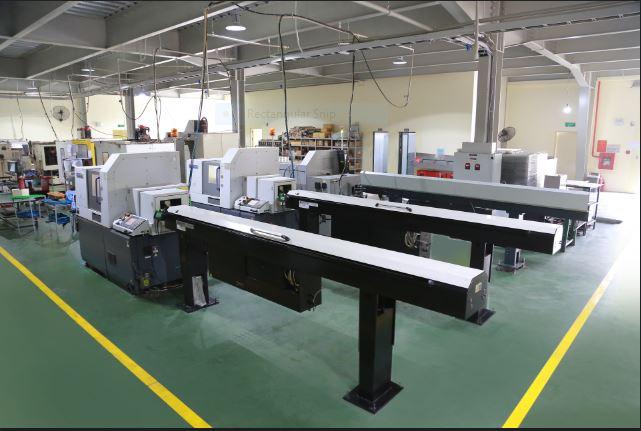 Máy tiện CNC cấp phôi tự động